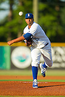 Burlington Royals starting pitcher Cesar Ogando (59) in action against the Danville Braves at Burlington Athletic Park on August 16, 2013 in Burlington, North Carolina.  The Royals defeated the Braves 1-0.  (Brian Westerholt/Four Seam Images)