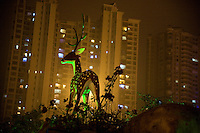 A statue resembling Pere David's Deer, a native Chinese species now only existing in captivity, decorates a parking lot in a luxury residential and shopping district in Haikou, Hainan, China.