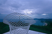 A Bertoia mesh chair on the terrace overlooking the dramatic view of the Itoshima peninsula