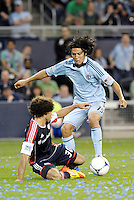 Roger Espinoza, (15) Sporting KC tackled by New England defender Kevin Alston (30)... Sporting Kansas City defeated New England Revolution 3-0 at LIVESTRONG Sporting Park, Kansas City, Kansas.