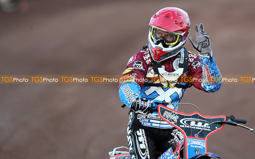 Davey Watt of Lakeside celebrates winning heat 4 - Lakeside Hammers vs Peterborough Panthers, Elite League Speedway at the Arena Essex Raceway, Pufleet - 10/05/13 - MANDATORY CREDIT: Rob Newell/TGSPHOTO - Self billing applies where appropriate - 0845 094 6026 - contact@tgsphoto.co.uk - NO UNPAID USE.