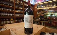 A 1.5 litre bottle of 2009 Lafite Moulin de Duhart Paulliac wine of A wine trader holds a 1.5 litre bottle of Moulin de Duhart Paulliac 2009 which sells for RMB7,330.00 at the official Chinese government-owned Guangzhou Friendship Store across town. But she was selling it for just RMB1,230.00 – about a hundred pounds.<br /> <br /> PHOTO BY SINOPIX<br /> <br /> PHOTO BY SINOPIX