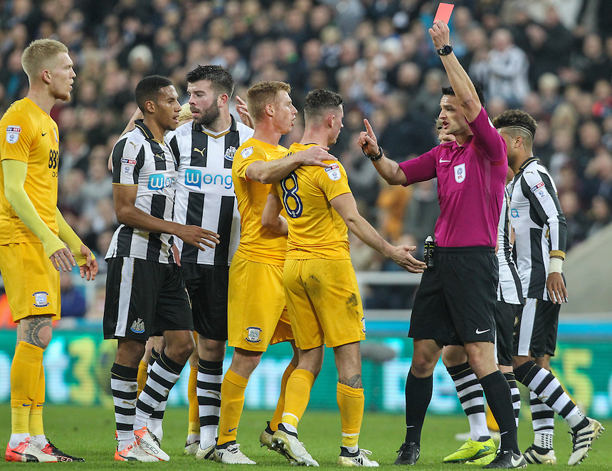 Referee Andrew Madley shows Preston North End's Alan Browne the red card after a challenge in the air with Newcastle United's Jack Colback<br /> <br /> Photographer Alex Dodd/CameraSport<br /> <br /> The EFL Cup 4th Round - Newcastle United v Preston North End - Tuesday 25th October 2016 - St James' Park - Newcastle<br />  <br /> World Copyright &copy; 2016 CameraSport. All rights reserved. 43 Linden Ave. Countesthorpe. Leicester. England. LE8 5PG - Tel: +44 (0) 116 277 4147 - admin@camerasport.com - www.camerasport.com