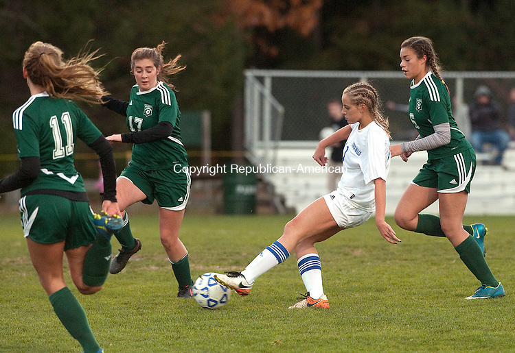 BURLINGTON,  CT-110716JS19- Lewis Mills' Chole Waldron  (11) fires a shot on goal past  Griswold's Zoe Lear (11) and Samantha Casey  (17) during their first round Class M tournament game Monday at Nassahegan Field in Burlington. . <br /> Jim Shannon Republican American