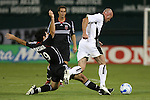20 Octoboer 2007: DC's John Maessner (19) tackles the ball from Hollywood's Frank LeBoeuf (FRA) (r). The 1997 DC United team defeated Hollywood United 2-1 in the Marco Etcheverry tribute match played before a regular season MLS game at RFK Stadium in Washington, DC.