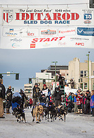 Martin Buser and team leave the ceremonial start line with an Iditarider at 4th Avenue and D street in downtown Anchorage, Alaska during the 2015 Iditarod race. Photo by Jim Kohl/IditarodPhotos.com