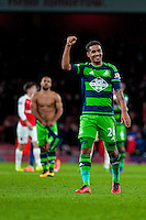 Kyle Naughton of Swansea City  celebrates after final whistle at the Barclays Premier League match between Arsenal and Swansea City at the Emirates Stadium, London, UK, Wednesday 02 March 2016