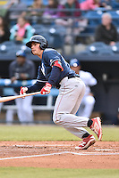 Lakewood BlueClaws left fielder Damek Tomscha (14) swings at a pitch during a game against the Asheville Tourists at McCormick Field on May 4, 2016 in Asheville, North Carolina. The Tourists defeated the BlueClaws 2-0. (Tony Farlow/Four Seam Images)