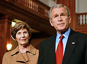 Washington, D.C. - December 22, 2006 -- United States President George W. Bush makes a statement and as first lady Laura Bush looks on after helping to wrap Christmas gifts destined for injured soldiers and their families who are staying at the Mologne House at the Walter Reed Army Medical Center in Washington, D.C. on Friday, December 22, 2006.<br /> Credit: Ron Sachs - Pool via CNP