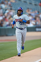 Vladimir Guerrero Jr. (47) of the Buffalo Bison heads towards home plate as he scores on a 2-run home run by teammate Rowdy Tellez (not pictured) during the game against the Charlotte Knights at BB&T BallPark on August 14, 2018 in Charlotte, North Carolina. The Bison defeated the Knights 14-5.  (Brian Westerholt/Four Seam Images)