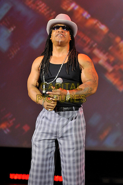 Melle Mel.performing at 'Something For Nothing: The Art of Rap'  European premiere, Hammersmith Apollo, London, England. 19th July 2012..show music live on stage concert gig.half length  black vest arms grey gray suit tartan checked plaid hat sunglasses microphone  necklace trousers .CAP/MAR.© Martin Harris/Capital Pictures.