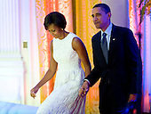 Washington, DC - July 21, 2009 -- United States President Barack Obama and First Lady Michelle Obama arrive at an event celebrating country music in the East Room of the White House in Washington DC, USA on 21 July 2009. Artists scheduled to perform included Charley Pride, Brad Paisley and Alison Krauss and Union Station. .Credit: Matthew Cavanaugh / Pool via CNP