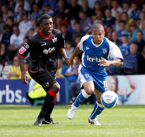 5th September 2009. Gillingham's Simeon Jackson runs past Troy Archibald-Henville during the first half. Division 1 match - Gillingham v Exeter City at Priestfield Stadium, Gillingham, Kent, England.Photo: Colin Read/Actionplus.