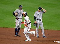 Baltimore Orioles shortstop Manny Machado (13), center, runs past New York Yankees shortstop Didi Gregorius (18), left, and second baseman Tyler Wade (12), right, after hitting his second home run of the game at Oriole Park at Camden Yards in Baltimore, MD on Tuesday, July 10, 2018.  The Orioles won the game 6 - 5.<br /> Credit: Ron Sachs / CNP<br /> (RESTRICTION: NO New York or New Jersey Newspapers or newspapers within a 75 mile radius of New York City) Credit: Ron Sachs/MediaPunch
