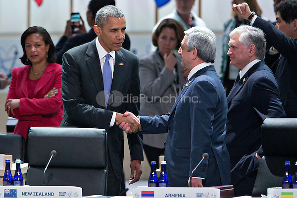 United States President Barack Obama left, shakes hands with Serzh Sargsyan, Armenia's president, during an opening plenary entitled &quot;National Actions to Enhance Nuclear Security&quot; at the Nuclear Security Summit in Washington, D.C., U.S., on Friday, April 1, 2016. After a spate of terrorist attacks from Europe to Africa, Obama is rallying international support during the summit for an effort to keep Islamic State and similar groups from obtaining nuclear material and other weapons of mass destruction. <br /> Credit: Andrew Harrer / Pool via CNP/MediaPunch