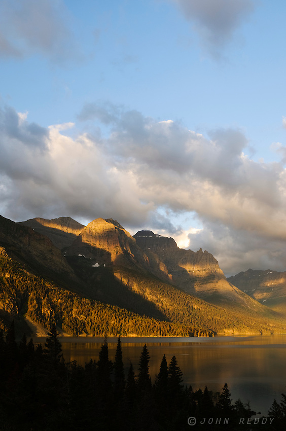 St. Mary Lake and Wild Goose Island bathed in dramatic light at sunrise