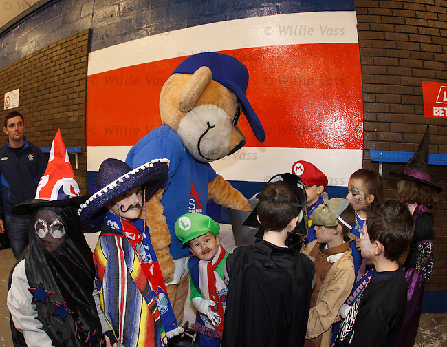 Broxi Bear with kids dressed up in Halloween garb in the Rangers Kids Section