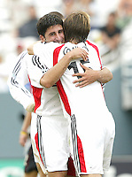 26 June 2004:  DC United Alecko Eskandarian celebrates with Bobby Convey after Eskandarian scored a goal to tie the game during the second half at Cotton Bowl in Dallas, Texas.   DC United and Dallas Burn are tied 1-1 after the game.   Credit: Michael Pimentel / ISI