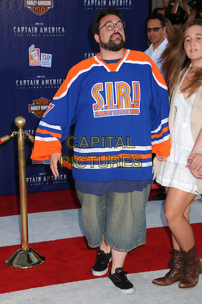 "Kevin Smith.""Captain America: The First Avenger"" Los Angeles Premiere held at the El Capitan Theatre, Hollywood, California, USA..July 19th, 2011.orange blue glasses beard facial hair full length s.i.r.! spodcast internet radio jean denim shorts.CAP/ADM/BP.©Byron Purvis/AdMedia/Capital Pictures."