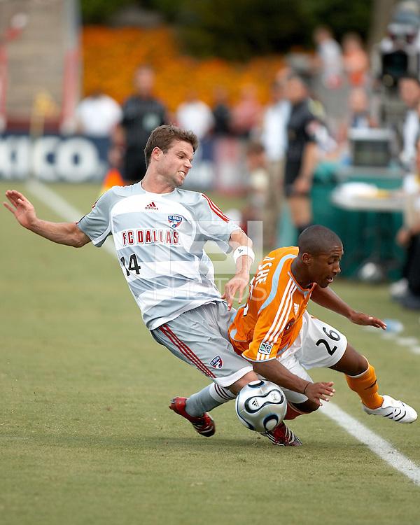 Houston Dynamo midfielder Corey Ashe (26) and FC Dallas defender Drew Moor (14) battle for the ball. Houston Dynamo beat FC Dallas 2-1 at Robertson Stadium in Houston, TX on June 3, 2007.