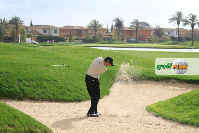 Peter Lawrie (IRL) plays his 2nd shot from a fairway bunker on the 16th hole during Friday's Round 2 of the Open de Espana at Real Club de Golf de Sevilla, Seville, Spain, 4th May 2012 (Photo Eoin Clarke/www.golffile.ie)