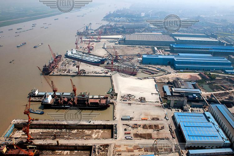 Ships dock at the Zhangjiagang Jiu Sheng Shipyard on the Yangtze River. /Felix Features