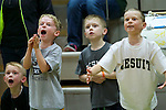 01/17/13--Mathew Kienow 6, Dylan Ruchaber 7, Daniel Kienow 9, and Caleb Ruchaber, 9, tries to distract Central Catholic Rams at the free throw line  during the Rams-Jesuit Crusaders game at Knight Center. <br /> Photo by Jaime Valdez