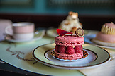 FRANCE, Paris, a rasberry Cake in Patisserie Laduree on a table, Saint Honore and Eclair cakes in the background