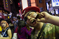 Man dressed as a revolutionary during the Halloween celebrations Shibuya, Tokyo, Japan. Saturday October 27th 2018. The celebrations marking this event have grown in popularity in Japan recently. Enjoyed mostly by young adults who like to dress up, drink , dance and misbehave in parts of Tokyo like Shibuya and Roppongi. There has been a push back from Japanese society and the police to try to limit the bad behaviour.