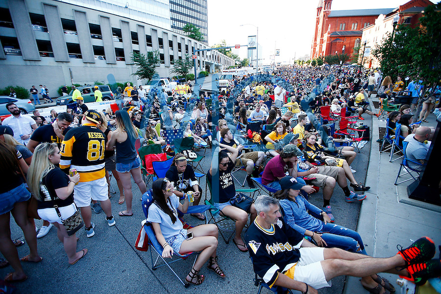 Fans sit along Washington Place prior to the start of game one of the Stanley Cup Final between the Pittsburgh Penguins and the San Jose Sharks at Consol Energy Center in Pittsburgh, Pennslyvania on May 30, 2016. (Photo by Jared Wickerham / DKPS)