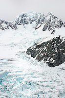 Fox Glacier and Mt. Tasman of Southern Alps, West Coast, Westland Tai Poutini National Park, South Westland, UNESCO World Heritage Area, South Island, New Zealand, NZ