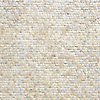 Staggered field, a hand-chopped stone mosaic, shown in 1.5cm tumbled Statuary Carrara, Heavenly Cream, Bianco Antico, and Botticino.