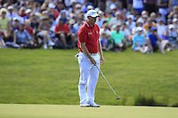 Stephen Gallacher (SCO) lines up his putt on the 18th green during Friday's Round 2 of the 2014 Irish Open held at Fota Island Resort, Cork, Ireland. 20th June 2014.<br /> Picture: Eoin Clarke www.golffile.ie