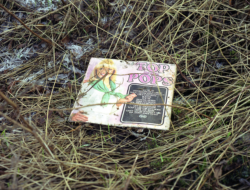 HATTERSLEY, UK - A discarded record litters the landscape on the Hattersley Estate.. .The Hattersley Estate was created in the early 1960s to house residents displaced by the slum clearances of inner city Salford and Manchester and soon gained notoreity between 1963 and 1965 as the home to the Moors Murderers, Myra Hindley and Ian Brady. Lying in a relatively isolated area on the edge of the Pennines, residents today continue to wait for the investment and infrastructure promised to them decades ago. In the gap between promise and reality, a unique characted formed during years of adversity continues to thrive on the estate.