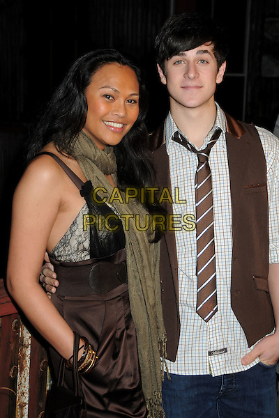 CASSANDRA HEPBURN & DAVID HENRIE .House of Blues Haiti Fundraiser Benefit for Project We.The.Children. held at The House Of Blues, West Hollywood, California, USA, 28th January 2010..half length waistcoat brown tie striped checked check plaid white shirt  Green khaki olive scarf lace bra hand in pocket .CAP/ADM/BP.©Byron Purvis/AdMedia/Capital Pictures.