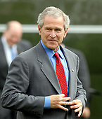 Washington, D.C. - July 24, 2007 -- United States President George W. Bush shows off his suit as he arrives on the South Lawn of the White House in Washington, D.C. on Tuesday, July 24, 2007 aboard Marine 1 after visiting Charleston Air Force Base, Charleston, South Carolina.<br /> Credit: Ron Sachs / Pool via CNP