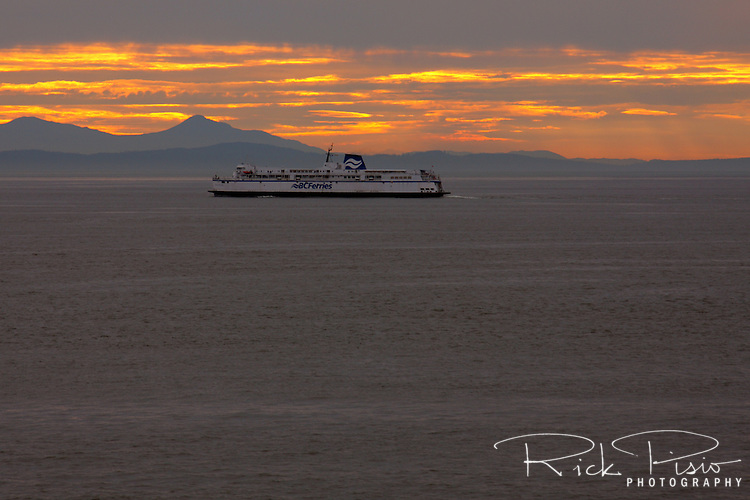 The BC Ferries Queen of Nanaimo crossing the Straight of Georgia at sunset after leaving the Tsawwassen Ferry Terminal