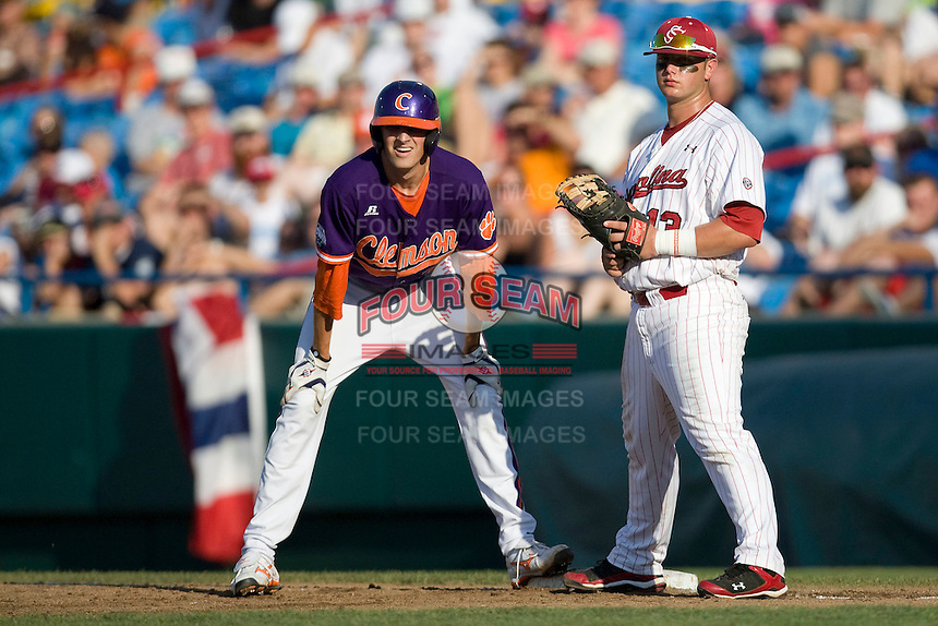 Clemson's Will Lamb and South Carolina's Christian Walker in Game 14 of the NCAA Division One Men's College World Series on June 26th, 2010 at Johnny Rosenblatt Stadium in Omaha, Nebraska.  (Photo by Andrew Woolley / Four Seam Images)