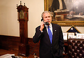 Washington, DC - November 4, 2008 -- United States President George W. Bush speaks with United States President-elect Barack Obama during a congratulatory phone call Tuesday evening, November 4, 2008, from the Treaty Room at the White House..Credit: Eric Draper - White House via CNP