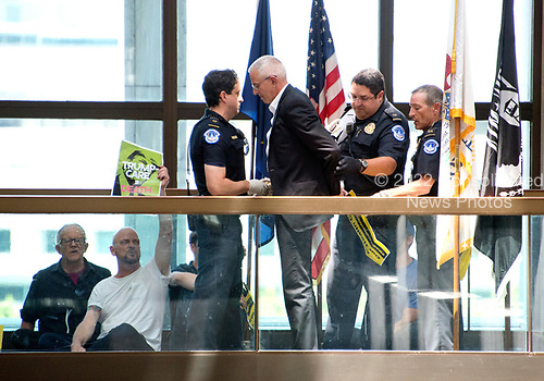 United States Capitol Police arrest protestors chanting &quot;Healthcare is a right&quot; outside the office of United States Senator Lisa Murkowski (Republican of Alaska) in the Hart Senate Office Building in Washington, DC on Wednesday, June 28, 2017.<br /> Credit: Ron Sachs / CNP