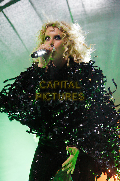 GOLDFRAPP - Alison Goldfrapp.Performing live in concert at the Roundhouse, Camden, London, England, UK, July 22nd 2010..music gig on stage half length microphone singing black tassels jacket top leggings sparkly  shiny .CAP/MAR.© Martin Harris/Capital Pictures.
