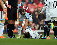 Pictured: Chico Flores of Swansea on the ground after the header challenge against Andy Carroll of West Ham which resulted in the former seeing a red card by match referee Howard Webb. 01 February 2014<br />