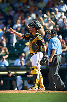 Pittsburgh Pirates catcher Ed Easley (70) signals two outs as umpire Tom Hallion looks on during a Spring Training game against the Boston Red Sox on March 9, 2016 at McKechnie Field in Bradenton, Florida.  Boston defeated Pittsburgh 6-2.  (Mike Janes/Four Seam Images)