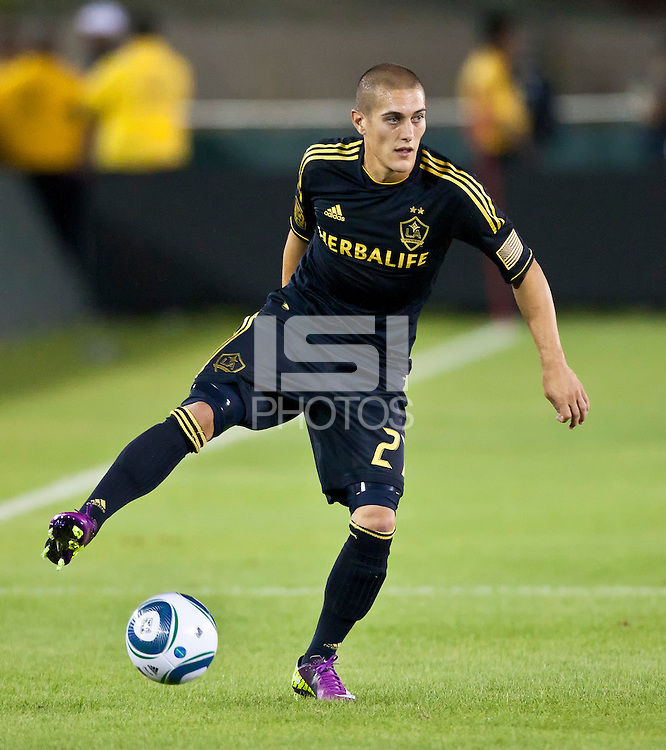 LOS ANGELES, CA – July 16, 2011: Bryan Jordan (27) of the LA Galaxy during the match between LA Galaxy and Real Madrid at the Los Angeles Memorial Coliseum in Los Angeles, California. Final score Real Madrid 4, LA Galaxy 1.
