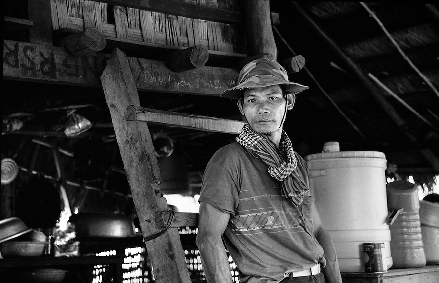 """Mekong Dam Victims - Cambodia. One of the villagers who was forced to relocate after the construction of the Yali Falls dam. At least 55.000 people living near the Sesan river in Cambodia's Ratanakiri and Stung Treng provinces continue to suffer due to lost rice production, lost fishing income, drowned livestock and damaged vegetable gardens, and so also great economical losses, because of the unpredictable floodings from the Yali Falls Dam on the other side of the border in Vietnam. To this day, flash floodings have caused the deaths of at least 39 villagers from various ethnic minority groups living along the river. Despite this, four other major hydropower projects are now in operation or under construction on the Sesan River in Vietnam. Known as """"The Mother of Waters"""", more than 60 million people depend on the Mekong river and its tributaries for food, fresh water, transport and other aspects of daily life. The construction of big dams is now threatening the life of these people aswell as the vital and unique ecosystem of the river."""
