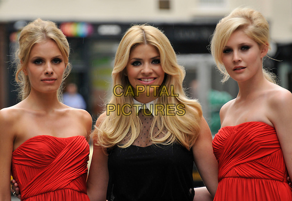 Holly Willoughby & models.Very.co.uk & This Morning presenter hosts event to debut her new range for online fashion retailer, Claridge's, London, England..June 27th, 2012.half length black dress models red strapless black white collar sheer .CAP/WIZ.© Wizard/Capital Pictures.