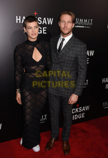 BEVERLY HILLS, CA - OCTOBER 24: Actor Luke Bracey (R) and guest attend the screening of Summit Entertainment's 'Hacksaw Ridge' at Samuel Goldwyn Theater on October 24, 2016 in Beverly Hills, California.<br /> CAP/ROT/TM<br /> &copy;TM/ROT/Capital Pictures