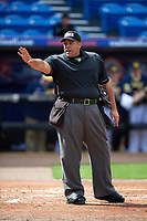 Umpire Kyle Reese warns the bench during the second game of a doubleheader against the Michigan Wolverines and Canisius College Golden Griffins on February 20, 2016 at Tradition Field in St. Lucie, Florida.  Michigan defeated Canisius 3-0.  (Mike Janes/Four Seam Images)