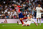 Luka Modric of Real Madrid (R) fights for the ball with Jorge Koke of Atletico de Madrid (L) during their La Liga  2018-19 match between Real Madrid CF and Atletico de Madrid at Santiago Bernabeu on September 29 2018 in Madrid, Spain. Photo by Diego Souto / Power Sport Images