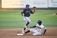 Missoula Osprey shortstop Jose Reyes (20) prepares to catch a throw while avoiding a slide by Cabera Weaver (7) during a Pioneer League game against the Great Falls Voyagers at Centene Stadium at Legion Park on August 19, 2019 in Great Falls, Montana. Missoula defeated Great Falls 1-0 in the second game of a doubleheader. (Zachary Lucy/Four Seam Images)